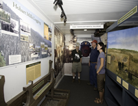 Volunteer showing logging & transcontinental exhibits